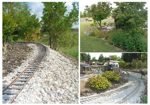 Graded track section, flowers and shrubs.